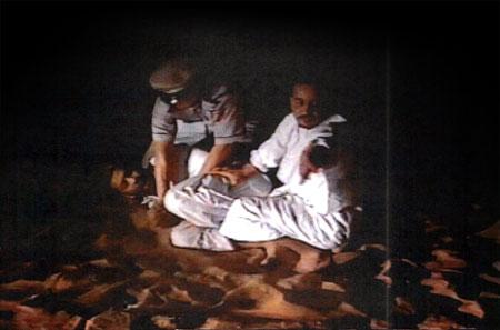 Sheikh Issa torturing an Afghan merchant.